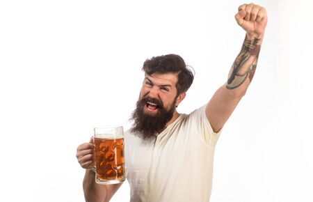 Emotional bearded drunk hipster male drinking craft beer from mug. Brewing. Stylish handsome man drinking beer of glass on party. Beer pub. Stylish guy at cafe pub. Beer time. Alcohol, harmful habits Stock Photo - 128953455