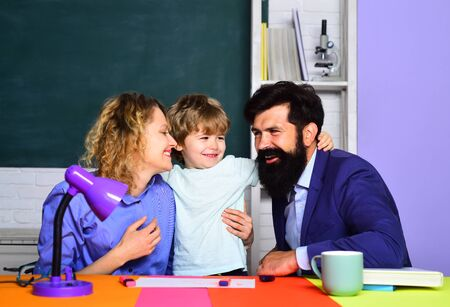 Back to school. Parents helps child boy. Home family schooling. Mathematics for kids. Schoolboy learning letters and numbers with parents. Parents teaching kid private lessons in math. Home schooling