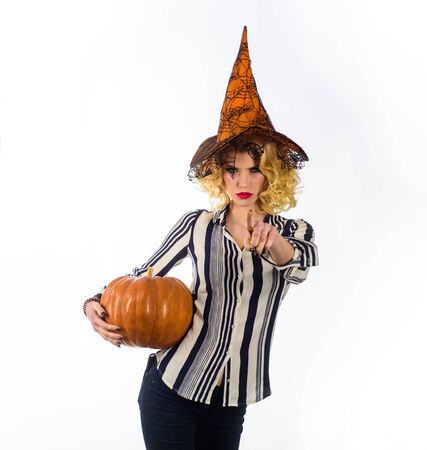 Preparation Halloween holidays. 31 October. Sensual girl in witch halloween costume with jack o lantern. Woman witch with pumpkin. Halloween party. Happy Halloween. Woman in witch hat with pumpkin Reklamní fotografie