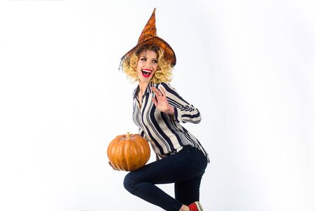 31 October. Smiling woman in witch halloween costume with jack o lantern. Preparation Halloween holidays. Woman witch with pumpkin. Halloween party. Happy Halloween. Girl in witch hat with pumpkin Reklamní fotografie