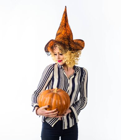 31 October. Sensual girl in witch halloween costume with jack o lantern. Preparation Halloween holidays. Woman witch with pumpkin. Halloween party. Happy Halloween. Woman in witch hat with pumpkin