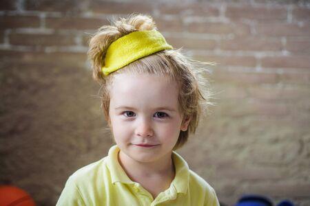 Kid sportsman. Healthcare. Sport fashion for kids. Cute little champion boy in sportswear. Kid in yellow t-shirt. Child in sport wear. Sporty children. Childhood activity. Healthy, fitness and sport
