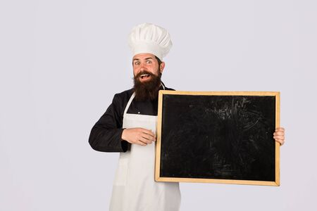 Empty menu chalkboard with copy space for text. Cooking, culinary, diet, advertisement and food concept. Chef menu. Professional chef on kitchen. Master chef, baker or cook shows menu sign blackboard