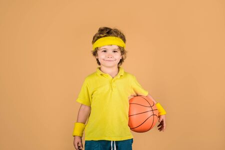 Basketball player. Kid playing with basketball. Boy in sportswear. Sport active. Sporty boy with ball. Hobby sport concept. Kid holds basketball. Sport, fitness, healthy lifestyle. Sport for children