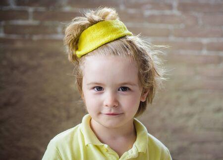 Kid sportsman. Healthcare. Healthy, fitness and sport. Sport fashion for kids. Cute little champion boy in sportswear. Kid in yellow t-shirt. Child in sport wear. Sporty children. Childhood activity