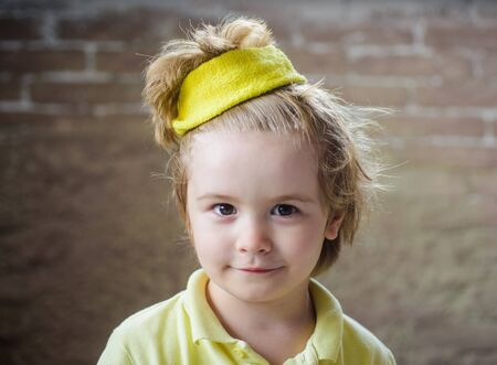 Kid sportsman. Sport fashion for kids. Cute little champion boy in sportswear. Kid in yellow t-shirt. Child in sport wear. Sporty children. Childhood activity. Healthcare. Healthy, fitness and sport