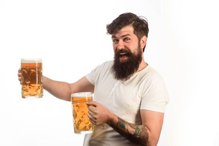 Bearded man drinking beer from glass at bar or pub. Bearded drunk hipster male holds craft beer. Stylish man with beard holds mug of beer. Bad habits. Drinks, alcohol, leisure and people concept