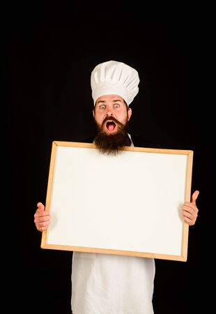 Chef menu. Man cook show empty menu chalkboard with copy space. Empty menu chalkboard with copy space for text. Male chef, cook or baker with blank board. Serious chef holds blackboard. Advertisement