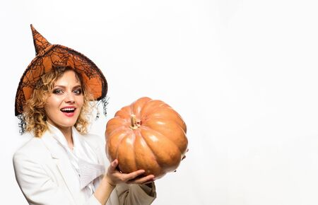 Trick or treat. Magic hat. Advertisement Halloween concept. Halloween Party girl. Happy Halloween Witch with Pumpkin. Happy Halloween Weekends. Young girl with Pumpkin. Party and traditional food Stock Photo