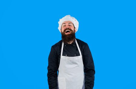 Bearded man in chef uniform. Male chef, cook or baker in white hat and apron. Professional happy man chef. Cooking, profession, business. Professional approach to business. Chef ready to cook new dish