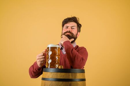 Beer in Germany. Beer pub and bar. Bearded man hold glass with delicious ale. Brewery concept. Bearded man drinking ale. Oktoberfest festival. Craft beer at restaurant. Man tasting draft beer. Brewer