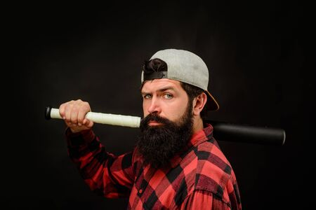 Sport, training, health. Baseball player with baseball bat. Sports and baseball training. Sport equipment. Fashionable man wearing plaid shirt. Power and energy concept. Bearded man with baseball bat