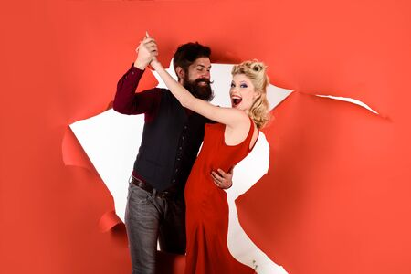 Happy couple enjoying dance. Stylish couple dancing. Romantic couple dance together at dance hall. Pretty woman and bearded man dancing. Dancing people in dance class. Cute young couple dancing