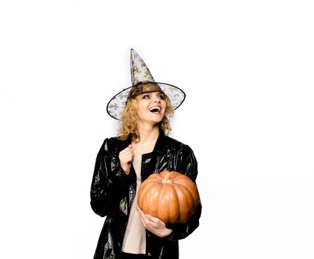 Trick or treat. Happy Halloween Witch with Pumpkin. Magic hat. Happy Halloween Weekends. Advertisement Halloween concept. Halloween Party girl. Young girl with Pumpkin. Party and traditional food