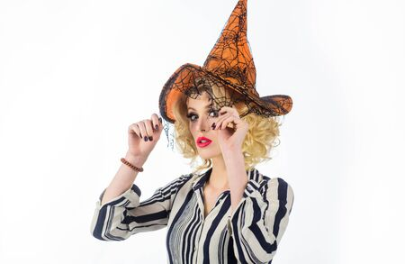 Happy Halloween. Witch magic. Halloween witch in magic hat. 31 october. Costumes and witch hats. Advertisement Halloween concept. Sensual woman dressing in Halloween costume with orange witchs hat