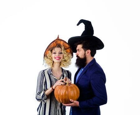 31 october. Jack o lantern. Magic for Halloween. Young people dressed at Halloween party. Celebration and party concept. Halloween couple in witches hats with pumpkin. Preparation Halloween holidays