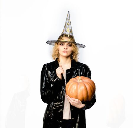 Happy Halloween. Girl with orange pumpkin. Halloween party. Serious woman in witch halloween costume with jack o lantern. Girl witch with Pumpkin. Happy Halloween Quotes and Sayings. Traditional food