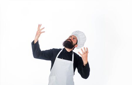 Bearded man in chef uniform. Chef ready to cook new dish. Male chef, cook or baker in white hat and apron. Professional happy man chef. Cooking, profession, business. Professional approach to business Stockfoto