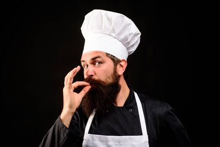 Bearded chef cook showing ok sign. Professional chef man in restaurant showing sign for delicious. Male chef gesturing okay. Chef in cook uniform with perfect sign. Cook or baker gesturing excellent