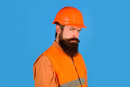 Repair, construction, building. Male builder or manual worker in protective helmet. Mechanical worker in uniform, hardhat. Construction worker in hard hat. Bearded man in suit and construction helmet Stockfoto