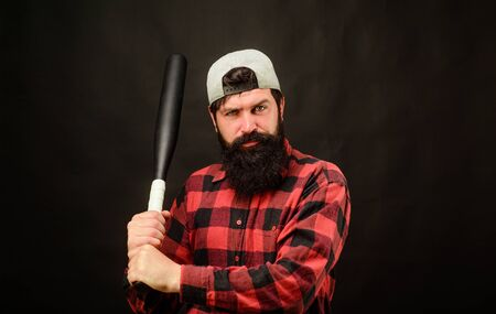 Sport, training, health. Power and energy concept. Bearded man with baseball bat. Baseball player with baseball bat. Sports and baseball training. Sport equipment. Fashionable man wearing plaid shirt