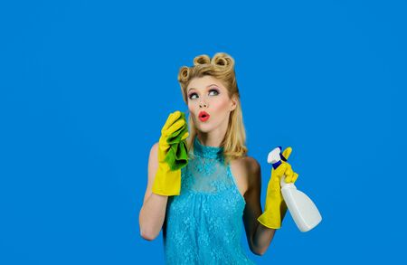 Cleaning service. Beautiful woman holds duster and spray. Cleaning tools. Happy retro housewife. Housewife ready for housework. Cleaning pin up woman. Girl cleaning with rag and bottle spray. Cleanup
