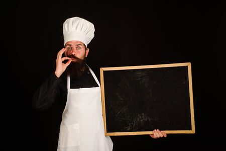 Chef menu. Happy chef hold blackboard. Advertisement. Man cook show empty menu chalkboard with copy space.