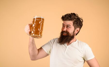 Oktoberfest. Beer pub and bar. Brewer. Craft beer at restaurant. Happy man drinks beer at pub. Bearded man hold glass with beer