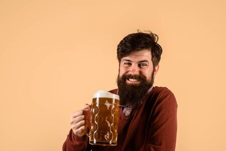 Alcohol. Oktoberfest. Germany traditions. Glass of beer. Celebration Oktoberfest. Happy bearded man with glass beer. Beer pub and bar. Brewery concept. Man tasting draft beer Stockfoto