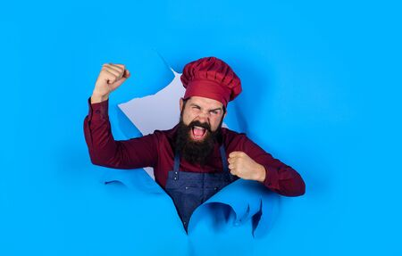 Bearded man through paper. Excited chef. Oatmeal. Professional chef. Bearded cook in kitchen. Chief man in cook uniform. Discount. Sale