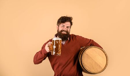 Wooden barrel of beer. Beer in Germany. Oktoberfest. Alcohol. Bearded man with wooden barrel of beer. Glass with beer
