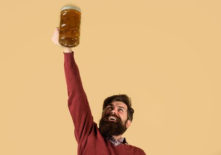 Alcohol. Oktoberfest. Germany traditions. Glass of beer. Celebration Oktoberfest. Happy bearded man with glass beer. Beer pub. Brewery concept. Man tasting draft beer Stockfoto