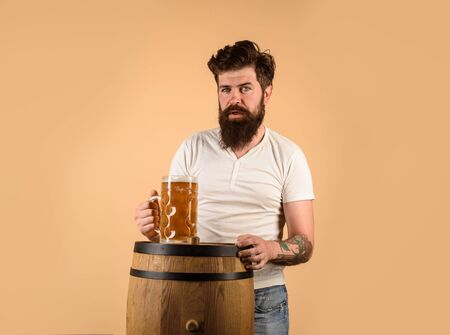 Brewery concept. Oktoberfest festival. Bearded man drinking beer. Pub and bar. Brewer. Craft beer at restaurant. Bearded man hold glass with delicious beer. Beer in Germany