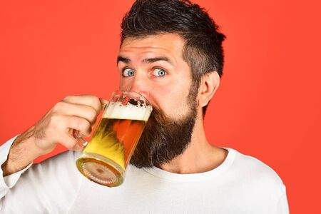Alcohol. Beer. Glass of beer. Oktoberfest. Bearded man with glass of beer. We meet oktoberfest. Bearded man drinking beer. Germany traditions