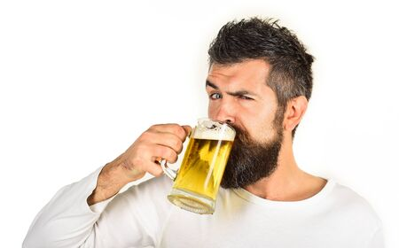 Beer pub. Beer time. Alcohol, harmful habits. Oktoberfest. Stylish handsome man drinking beer of glass on party. Smiling bearded hipster drinking craft beer from mug. Brewing. Stylish guy at cafe pub