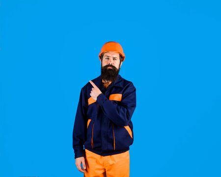 Building. Industry. Technology. Builder in hard hat. Man builder in uniform. Bearded man in construction helmet. Mechanical worker. Industrial worker. Construction worker in hardhat Banco de Imagens