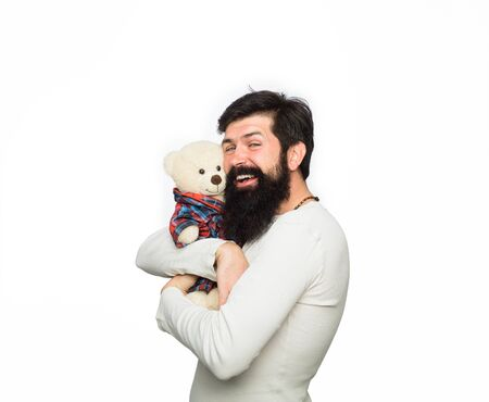 Bearded man hugging teddy bear. Gift and present concept. Happy man with plush toy. Fashion and style. Birthday or anniversary and holiday celebration. Teddy bear present. Happy man with teddy bear