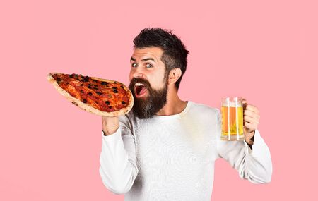Man eating pizza. Happy woman eating pizza and holds beer. Food. Lunch. Pizza. Alcohol. Beer. Fastfood. Snack. Food delivery. Pizza slice. Tasty food