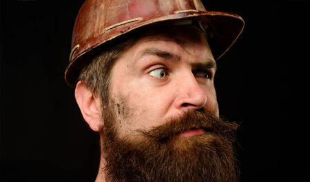 Construction worker in hardhat. Man builder. Closeup. Serious builder in hard hat. Business, building, industry, technology. Bearded man in construction helmet. Mechanical worker. Industrial worker 写真素材