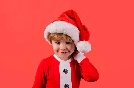 Santa helper. Elf. Little klid in Santa costume. Santa Claus. Gifts. New Year. Happy New Year. Christmas kids. Holiday. Kid in santa hat. Christmas. New year kid. Close up Stock Photo - 132114029