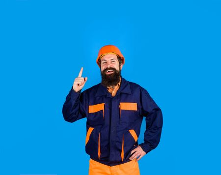 Construction worker. Business, building, industry, technology. Mechanical worker. Builder in hard hat. Man builder in hardhat. Bearded man in overalls and construction helmet. Industrial worker 写真素材