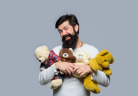 Teddy bear present. Gift and present concept. Male with teddy bear. Bearded man hugging teddy bear. Bearded man with plush toy. Fashion and style. Birthday or anniversary and holiday celebration