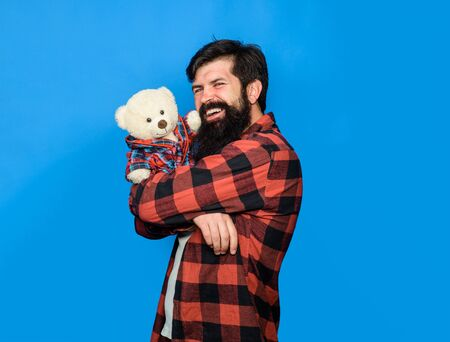 Birthday or anniversary and holiday celebration. Teddy bear present. Gift and present concept. Male with teddy bear. Bearded man hugging teddy bear. Bearded man with plush toy. Fashion and style Zdjęcie Seryjne - 132114354