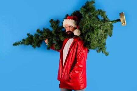 Christmas Santa. Gifts. New year tree. Christmas decorations. Santa Claus hold New year tree. Santa Claus gifting. New year gift. Christmas tree 版權商用圖片