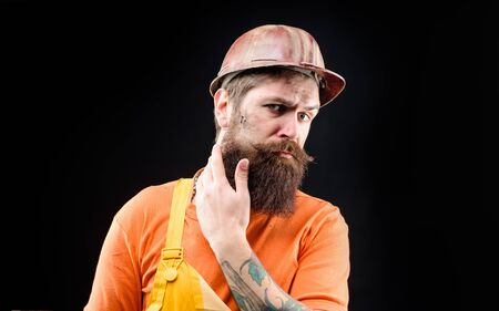 Building, industry, technology. Builder in hard hat. Man builder. Bearded man in construction helmet. Mechanical worker. Industrial worker. Construction worker in hardhat