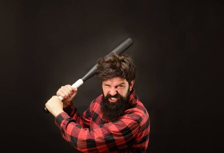 Sport, training, health. Angry man in plaid shirt ready to swing. Power&energy concept. Bearded man with baseball bat. Baseball player with baseball bat. Sports and baseball training. Sport equipment