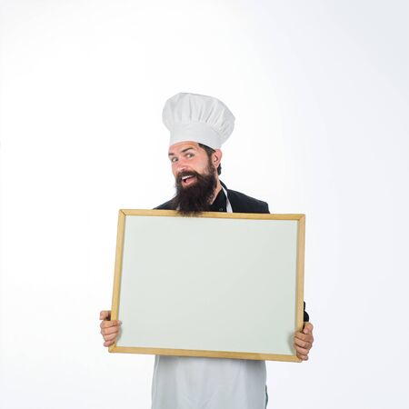 Advertising chef menu. Business lunch menu. Bearded chef holds blackboard. Restaurant chef show empty chalkboard. Blank chalkboard with copy space for text. Male chef, cook or baker with blank board Banque d'images