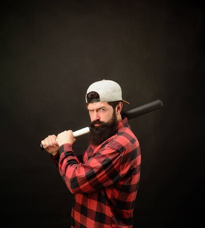 Angry man in plaid shirt ready to swing. Sport, training, health. Power&energy concept. Bearded man with baseball bat. Baseball player with baseball bat. Sports and baseball training. Sport equipment