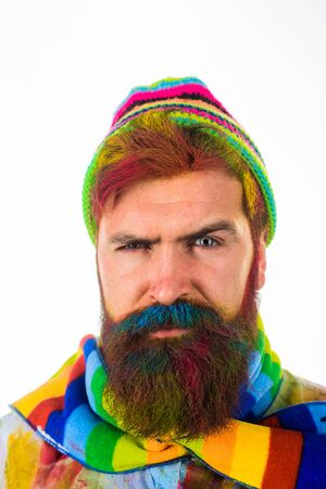 Autumn fashion. Bearded man in trendy colorful scarf and hat. Autumnal vogue trend. Bearded man in autumn style. Comfortable autumn outfit. Seasonal fashion concept. Bearded man in colorful clothing