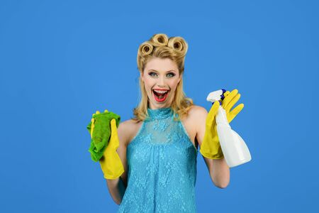 Cleaning service. Cleaning woman. Cleanup. Cleaning tools. Beautiful woman holds duster and spray. Happy retro housewife. Housewife ready for housework. Girl cleaning with rag and bottle spray